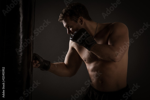 Poster Training On A Punching Bag