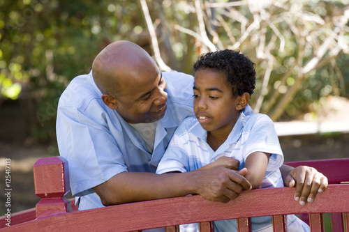 Pareneting. Father talking with his son. Poster