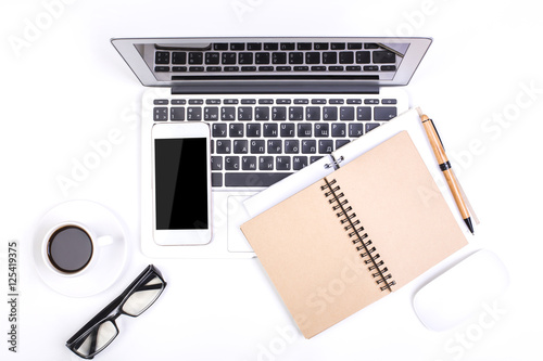 Office desktop with notepad and technology © peshkova
