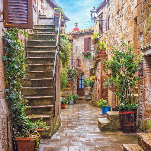 Fototapeta Alley in Italian old town, Tuscany, Italy