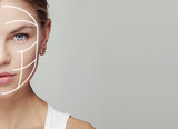Close-up portrait of attractive young woman face with massage lines. Concept of skin rejuvenation, smooth and correction.  - 125480950