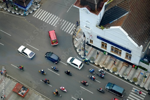 Plakat Traffic intersection with cars and motorcycles, in asia afrika street, bandung,