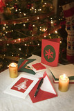 selection of home made Christmas cards on a table with envelopes