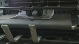Printing Process on polygraph industry - brochures moving on the conveyor belt, slider