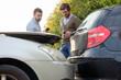 Men calling car mechanic insurance assistance after car acciden