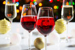 Red wine glasses and christmas balls