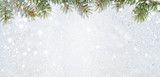 christmas card or new year background made of glittering snowflakes with fir-tree branches