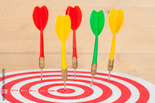 Poster dart arrow and dartboard on wood background