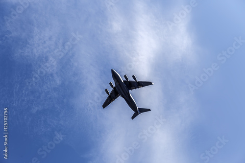fighting military plane in the sky плакат