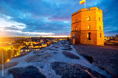 View on the illuminated old tower on the castle hill in the old town of Vilnius city in Lithuania. This tower is very popular tourist destination in Vilnius