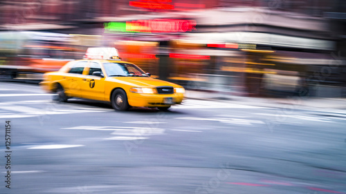 NYC taxi in motion. Blurred, long exposure images.