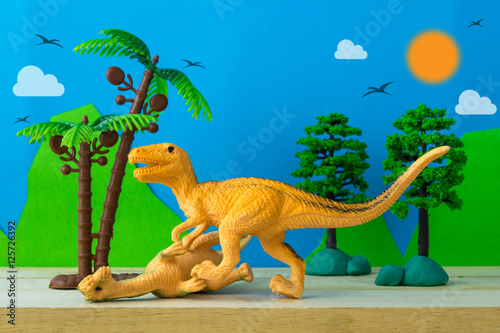 Dinosaur fight scene on wild models background Poster