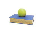Blue book white green apple on it isolated on white background