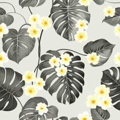 Tropical flowers and jungle palm. Beautiful fabric pattern with a tropical plumeria isolated over gray background. Seamless texture. Vector illustration.