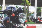 close up. vintage motorcycle on the road with a helmet. over light and retro tone [blur and select focus background]