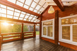 Large Porch of the log cabin at sunset - 125822160