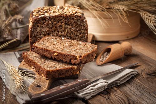 Fototapeta Whole Grain rye bread with seeds.
