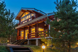 Modern Log Cabin Home in a Forest Environment - 125832713