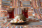 Traditional Turkish tea on the colored tablecloth