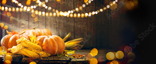 Thanksgiving Day. Autumn Thanksgiving pumpkins over wooden background
