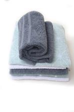 Pila Di Asciugamani Su Sfondo Bianco Sticker