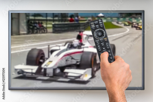 Fotobehang Formule 1 Man is watching formula one racing on TV