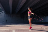 Fit woman runner warming up outdoors - 125974585