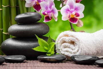 spa still life with zen basalt stones ,orchid and bamboo