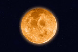 Supermoon - full moon on night sky. Elements of this image furnished by NASA.