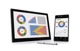 ビジネス資料をモニターするタブレットとスマートフォン