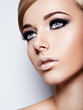 Portrait of fashion model with  black makeup of eyes. Pretty at