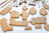 Baked gingerbread cookies for christmas 3D composition on wooden table, spices on background, horizontal