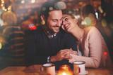 Romantic couple dating in pub - 126003153