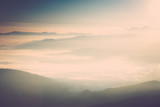 Foggy mountains at sunrise.