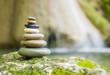 Rock Zen Stack in front of waterfall.