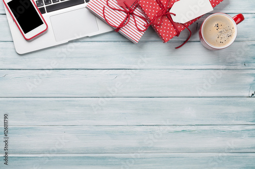 Christmas gift boxes, pc and coffee cup on wood Poster
