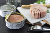 canned tuna on the plate - 126017372