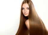 Fototapety Beautiful blonde woman with long, healthy , straight  and shiny hair.  Hairstyle loose hair