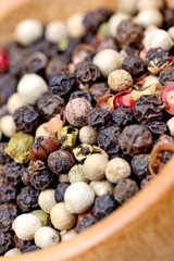 Colorful peppercorns in a bowl