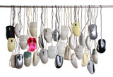 Hanging computer mice isolated on white background