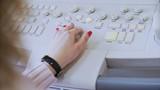 Doctor hands regulating ultrasound machine