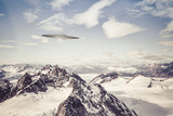 UFO over Alaskan Mountains
