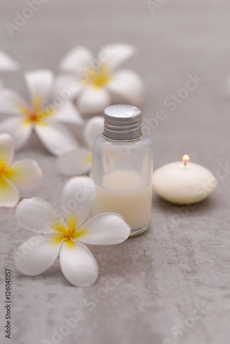 Fotobehang Spa Spa stone with frangipani ,massage oil ,candle on grey background.