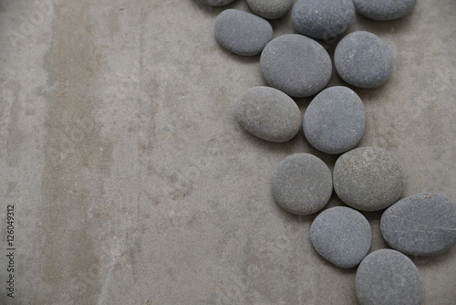 Poster Spa set of pile of stones on gray background