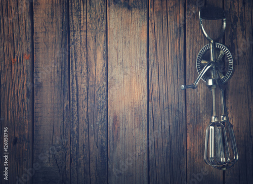Poster Whisk Beating Eggs on wooden background