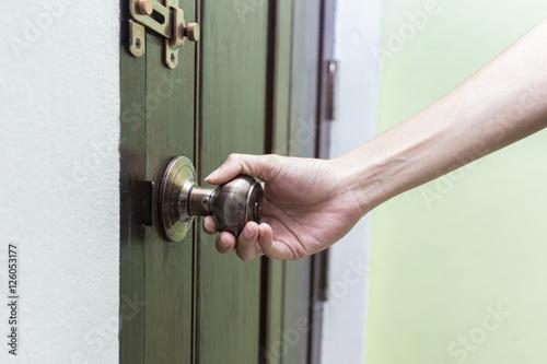 Poster hand hold handle of wood door