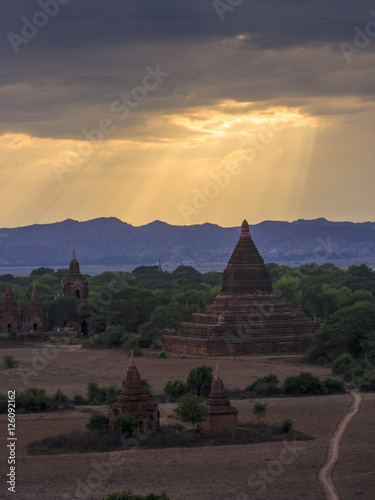 Poster pagodas (temples) in Bagan Myanmar under cloudy sky and natural