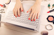 woman writing fashion blog. laptop and accessories on the table