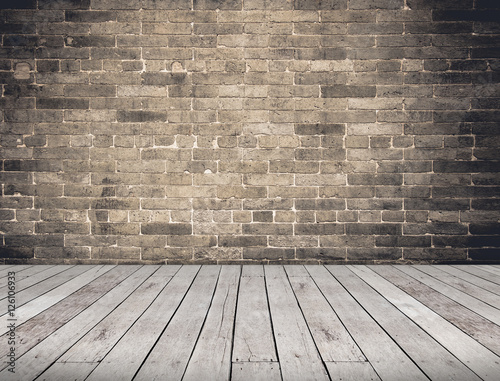 Fototapeta Empty Room perspective,grunge brick wall and wood plank floor, M
