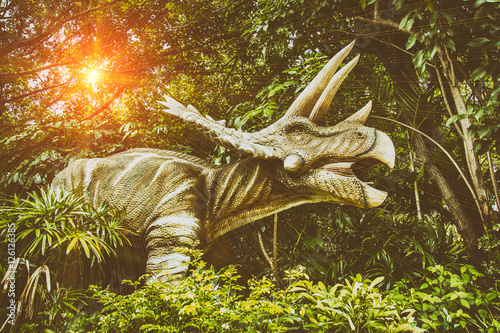 Poster dinosaur toy in the forest in thailand